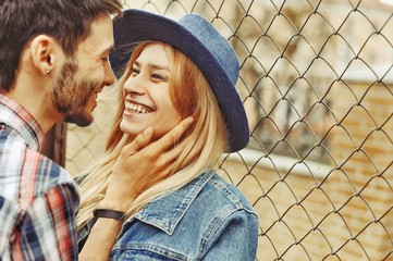 Beautiful young couple in love - close up outdoor portrait