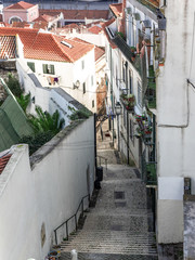 Lisbon - Portugal, stairway in a narrow alley of the Alfama district