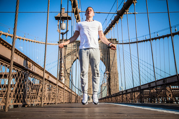 Young athlete jumping rope on Brooklyn Bridge in New York City