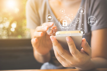 Woman using smartphone with icon graphic cyber security network of connected devices and personal data information - fototapety na wymiar