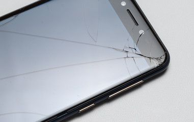 Close-up of phone or tablet with broken screen