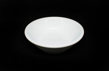 porcelain bowl on black background