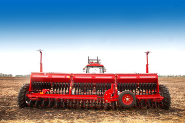 Wall Mural - Modern tractor in the field with complex for the plowing of soil.