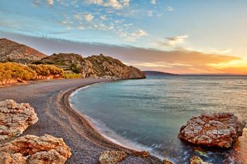 Sunrise at the beach Mavra Volia in Chios, Greece