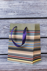 Image of gift bag on wooden background. Paper shopping bag design. Gift packing bags.