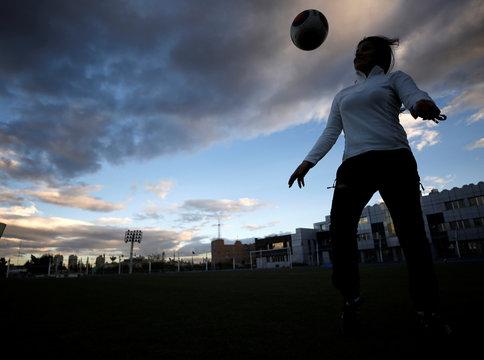 Maha Jannoud, 32, plays with a ball at al-Muhafaza sports club stadium in Damascus