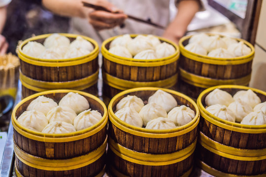 Street food booth selling Chinese specialty Steamed Dumplings in Beijing, China