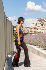 Young Indian woman posing in an urban context