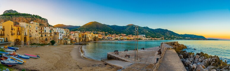 Panoramic view over the italian coastal city Cefalu with harbour and colorful old houses at sunrise, Sicily, Italy