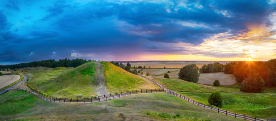 Sunset over Royal Mounds in Gamla Uppsala, Uppland, Sweden (HDR pnorama)