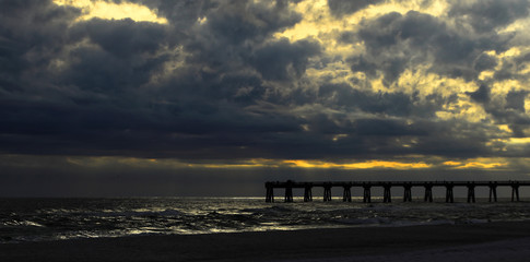Fishing Pier at dusk with gathering storm