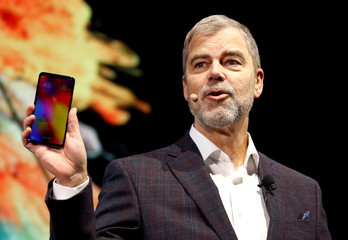 David Vanderwaal, senior vice president of marketing for LG Electronics USA, holds up an LG V40 phone during an LG Electronics news conference at the 2019 CES in Las Vegas