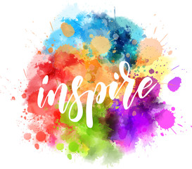 Inspire handwritten message on watercolor splash