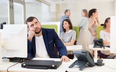 Pensive businessman in coworking space