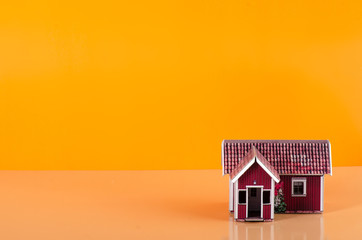 Small house miniature business on orange background