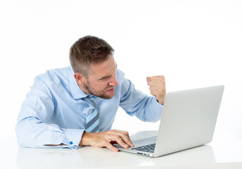 Businessman overwhelmed and desperate at work angry yelling at laptop computer