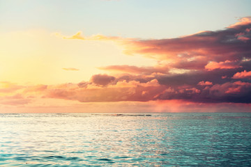beautiful colorful sea sunset with heavy clouds