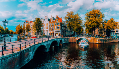 Panorama of Amsterdam. Famous canals und bridges at warm afternoon light. Netherlands Wall mural