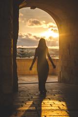 Girl walking in a medieval castle