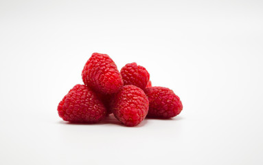 small bunch of ripe red raspberries isolated on white