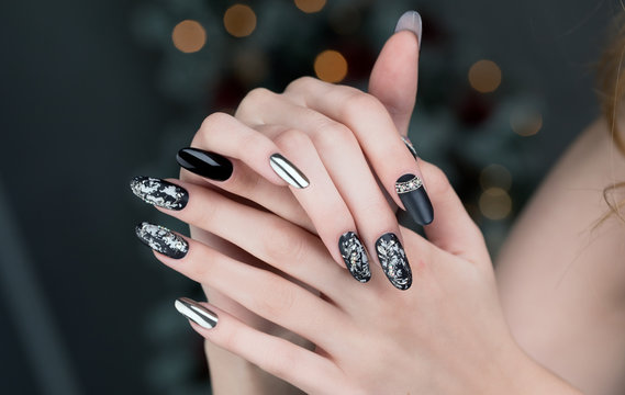 Close up on beautiful female hands with  Nail Art  manicure.