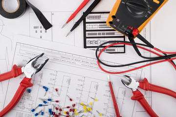Obraz Tools for electrical installations laid on electrical schemes - fototapety do salonu