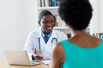 African american doctor with good news for female patient