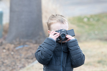 Four Year Old Toddler Boy Taking Photos Outside with a Digital Camera