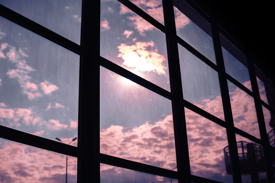 Vintage filtered picture of sun in a tinted window