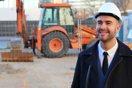 Architect smiling in construction site