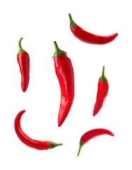 Canvas Prints Hot chili peppers Set with fresh red chili peppers falling against white background