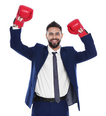Happy young businessman with boxing gloves celebrating victory on white background