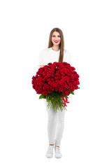 Full length portrait of beautiful woman with bouquet of roses on white background