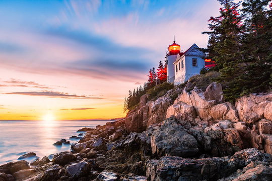 Bass Harbor Head lighthouse at sunset. Bass Harbor Head Light is a lighthouse located within Acadia National Park, Maine, marking the entrance to Bass Harbor and Blue Hill Bay