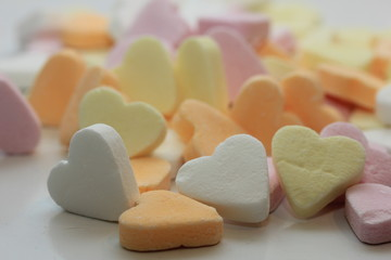 Pastel colored candy hearts