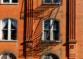 Red brick wall with fire escape