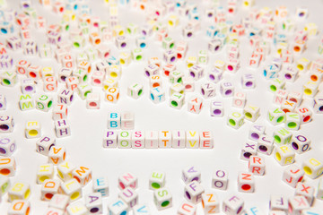 Conceptual of Motivational Words made with Colorful Alphabetical Beads