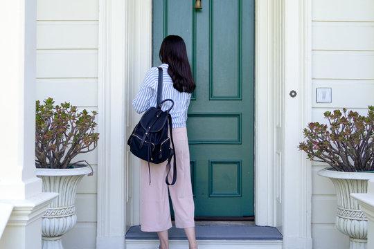 girl back to home using key opening door