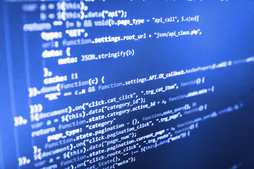 Programmer working in computer screen. Programming on monitor background. PHP development, software site code. Creative Js HTML5 closeup set on background. Design write technology background.