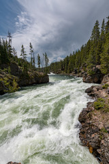 The Yellowstone river plunging down into the grand canyon of yellowstone.