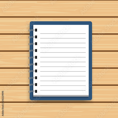 Blank realistic spiral notepad notebook on wooden background