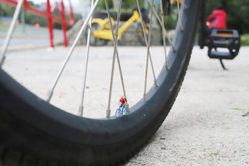 a mini of figure ride the bike on wheel