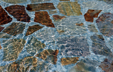 Bottom of swimming pool with stone
