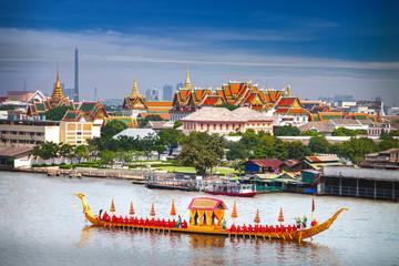 Royal Boat and river with grand palace background in Bangkok city Wall mural
