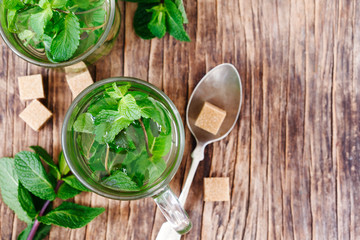 Cup of Mint tea on wooden background