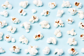pattern of popcorn on a blue background close-up, top view, texture