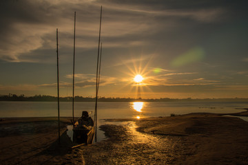 Before sunrise in morning and boat with in the beach and river background.