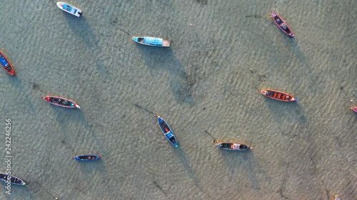 aerial view fishing boats stuck in the sea during low tide