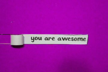 You are Awesome, Inspiration, Motivation and business concept on purple torn paper