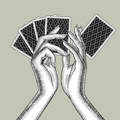 Female hands with playing cards fan